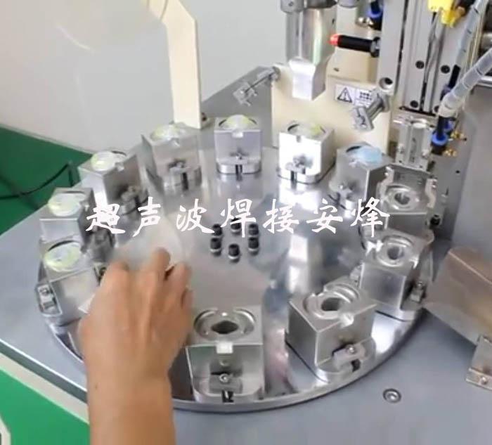 20K奶嘴盖单轴机械手超声波自动化转盘焊接机
